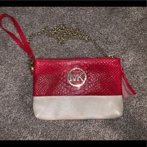 Red Michael Kors handbag